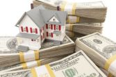 house_money_pile_shutterstock_83573653